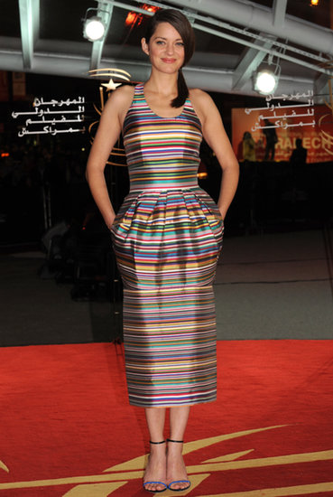 This colorful striped Dior dress fit Marion Cotillard perfectly when she wore it on the A Thousand Times Good Night red carpet in Marrakech.