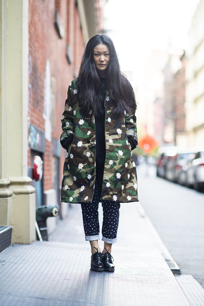 Layers don't mean covering up your style — a bold camo-print coat was the perfect way to show it off.  Source: Le 21ème | Adam Katz Sinding