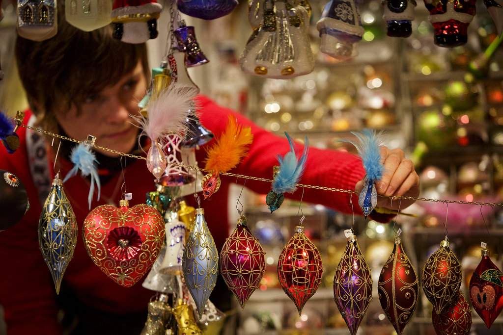 A vendor arranged Christmas ornaments at Prague's Christmas market.
