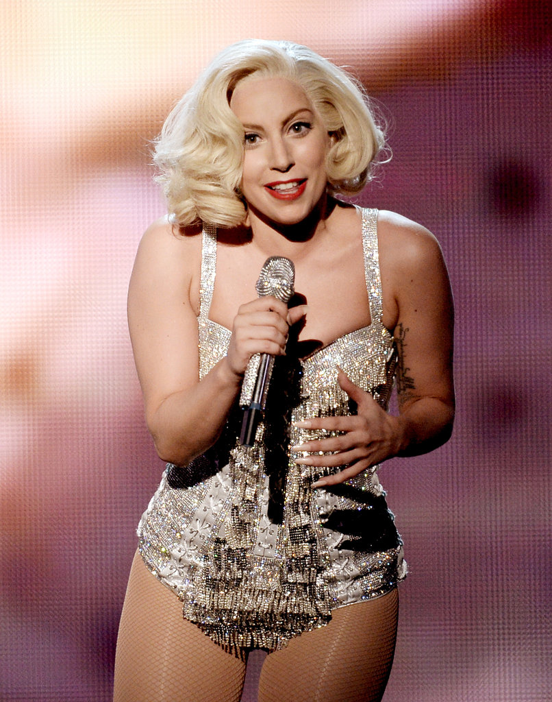After the AMAs red carpet, she acted out her best Marilyn Monroe impersonation on stage in a curly blond bob.