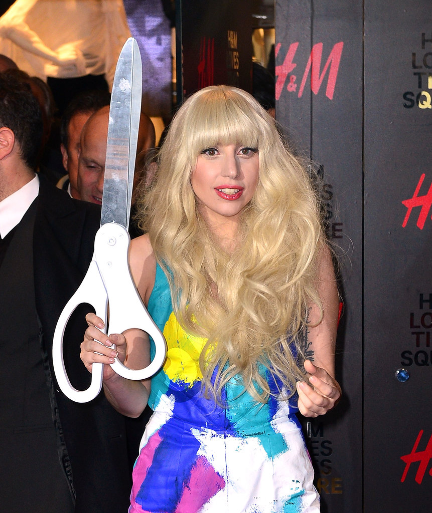 At the opening of the Times Square H&M, Lady Gaga wore a long, curly wig with bangs, which was one of her more average looks.
