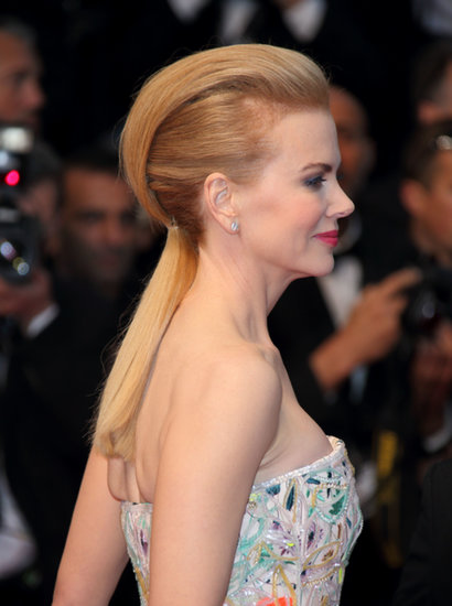 The ponytail might be your go-to casual style, but pump up the look for the holidays with a pompadour similar to Nicole Kidman's Cannes hairdo.