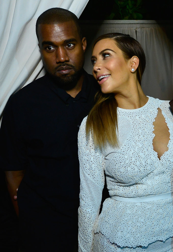 Kim Kardashian flashed her smile at Kanye West  during a bash hosted by DuJour magazine in Miami.