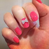 Our Instagram followers are in a festive mood, it seems. This bow nail art was one of the top taps of the week.