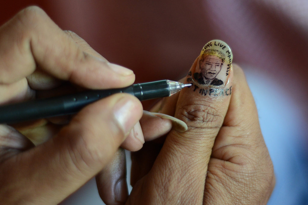A woman created Nelson Mandela nail art in India.