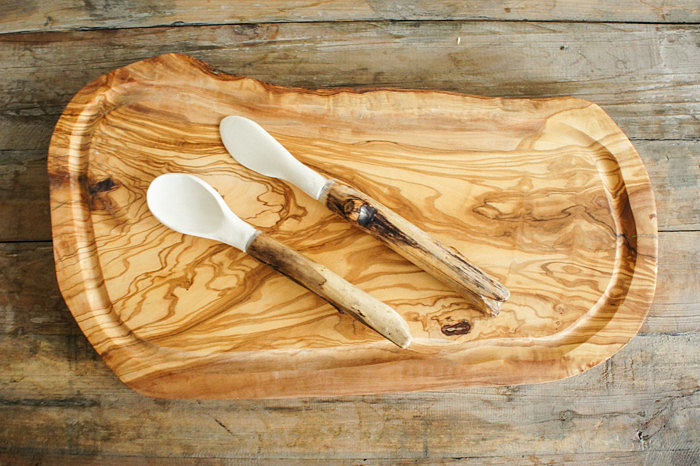 Heading to a foodie's new home? Pair this wood cutting board ($64) with a nice gourmet cheese and a bottle of wine for a fun-meets-functional option.