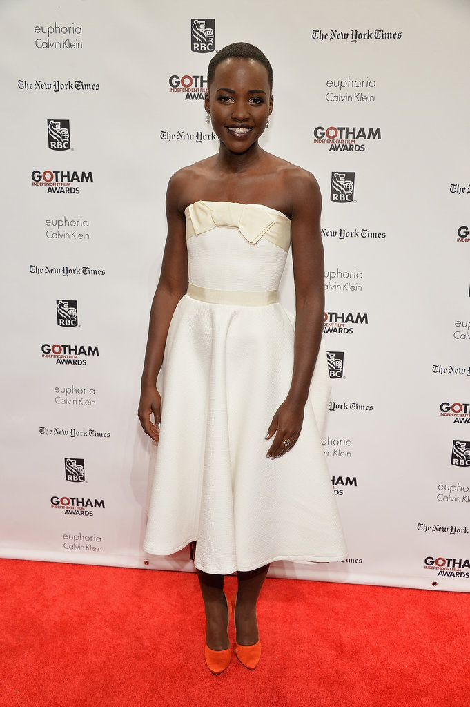 After a string of colorful hits (whether that meant a bright dress, bold lips, or both!) Lupita Nyong'o toned it down for the Gotham Independent Film Awards with a white Lanvin design, which she paired with the label's vibrant pumps, naturally!