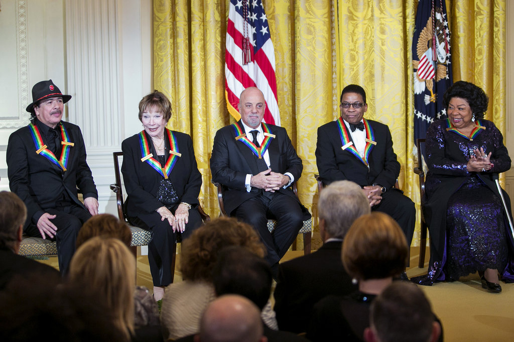 The five honorees included Carlos Santana, Shirley MacLaine, Billy Joel, Herbie Hancock, and Martina Arroyo.