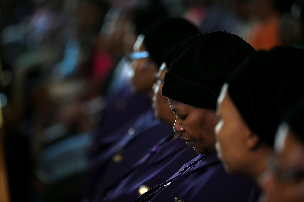 A woman bowed her head during a church service held on South Africa's national prayer day.