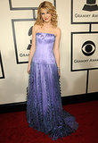 Only Taylor could pull of this lavender silk Sandy Spika custom-made gown.