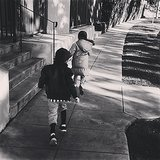 The race was on as Joel Madden's kids — Harlow and Sparrow — took off down the sidewalk. Source: Instagram user joelmadden