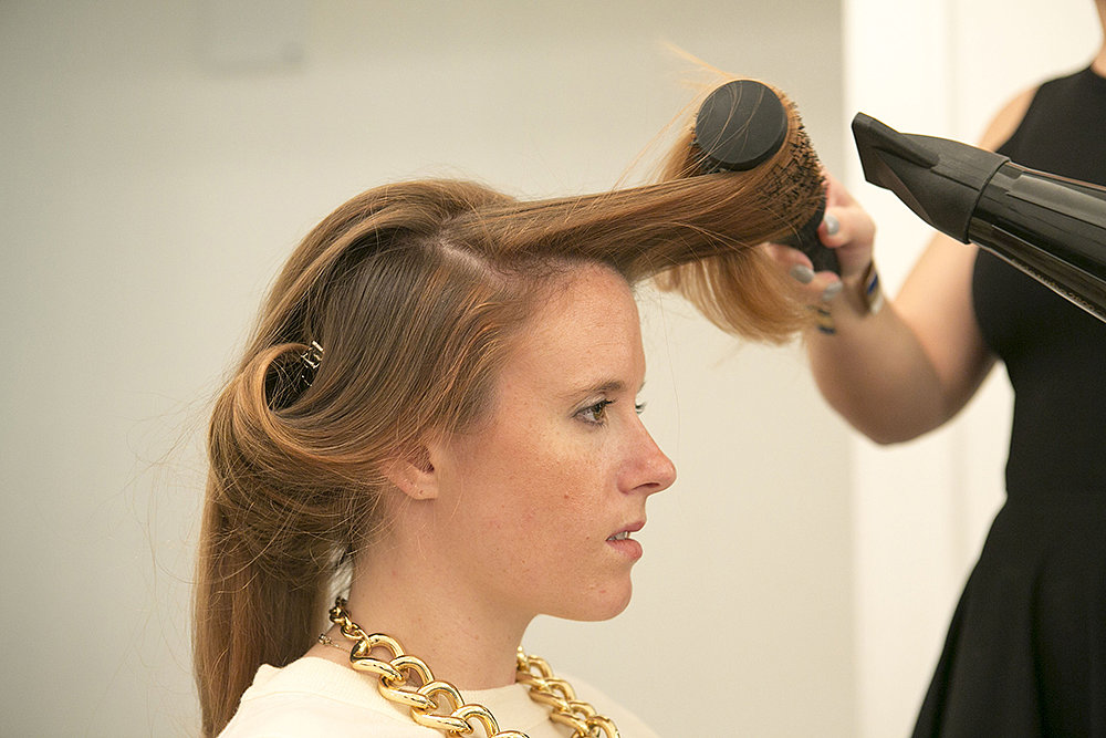 When you're blow-drying the top section that frames your face, you'll want to keep the section of hair curled away from your face. Don't forget to smooth the strands along your hairline before moving to the ends.  Source: Caroline Voagen Nelson