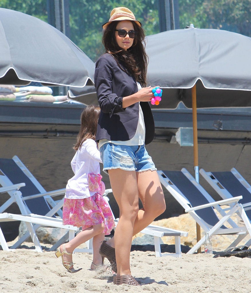 Only Suri Katie is allowed to wear heels to the beach. The actress chose a navy blazer, distressed denim shorts, and woven sandals for a May 2011 beach day.