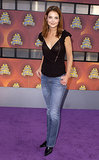 Looking fresh-faced in a ruffle-sleeved top and whiskered denim for the 2002 MTV Movie Awards.