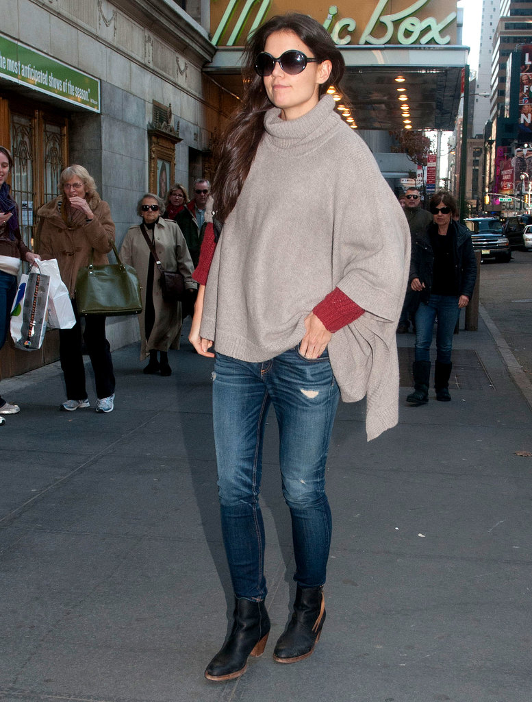 Katie nailed cozy-chic in swapping a standard jacket for a few layered knits — gray White + Warren poncho and ribbed red long-sleeve — with distressed denim and black motorcycle boots in Fall 2012.