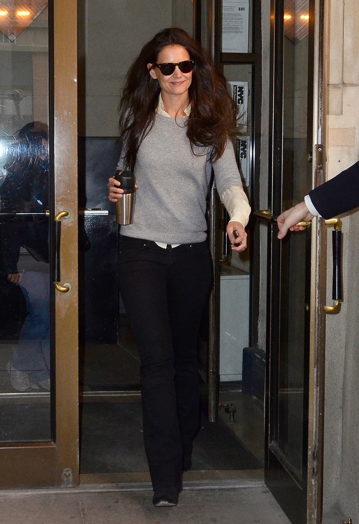 In March 2012, Katie was all smiles in a three-quarter-sleeved sweater layered over a creme blouse with midnight-blue flares.