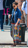 Topping her colorful printed maxi and studded sandals with an oversize denim jacket while lunching in NYC in June 2013.