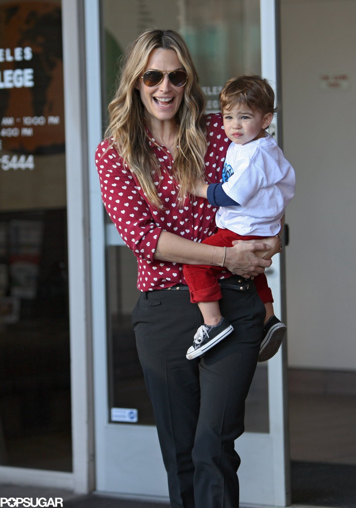 Molly Sims was all smiles while holding her son, Brooks Stuber, in LA on Sunday.