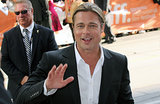 Brad Pitt gave a smile and wave while arriving for the Toronto International Film Festival premiere of 12 Years a Slave in September 2013.