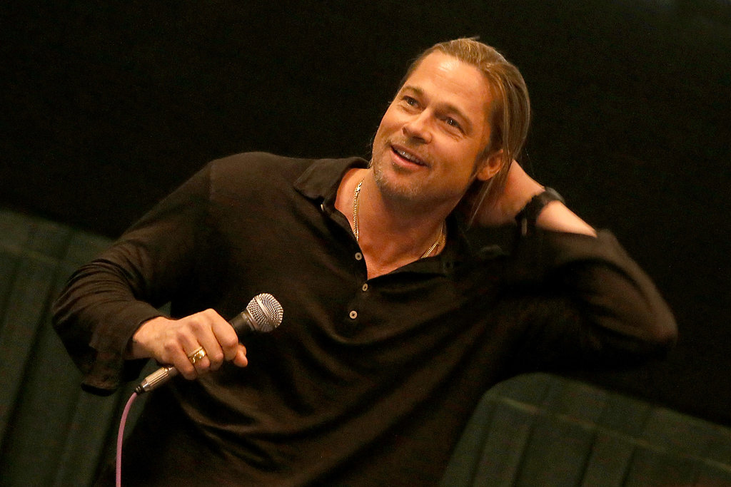 Something about Brad Pitt in this relaxed, super-chill pose makes us swoon — he was looking hot and laid-back at a special screening of World War Z in Austin, Texas, in June 2013.