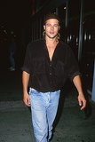 Brad Pitt hid his longer locks under a backward baseball cap during a night out in LA in January 1992.