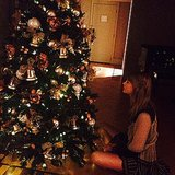 Taylor Swift received a warm holiday welcome at her hotel in Australia, posting this photo of her admiring the decked-out Christmas tree. Source: Instagram user taylorswift