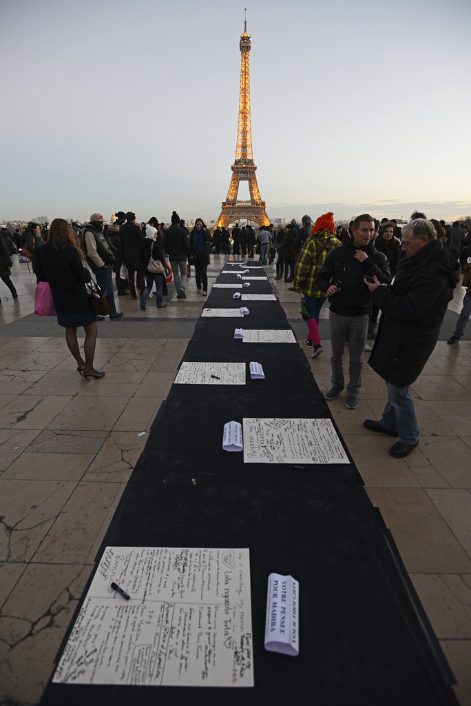 People signed cards and snapped photos at the Nelson Mandela tribute in Paris, France.