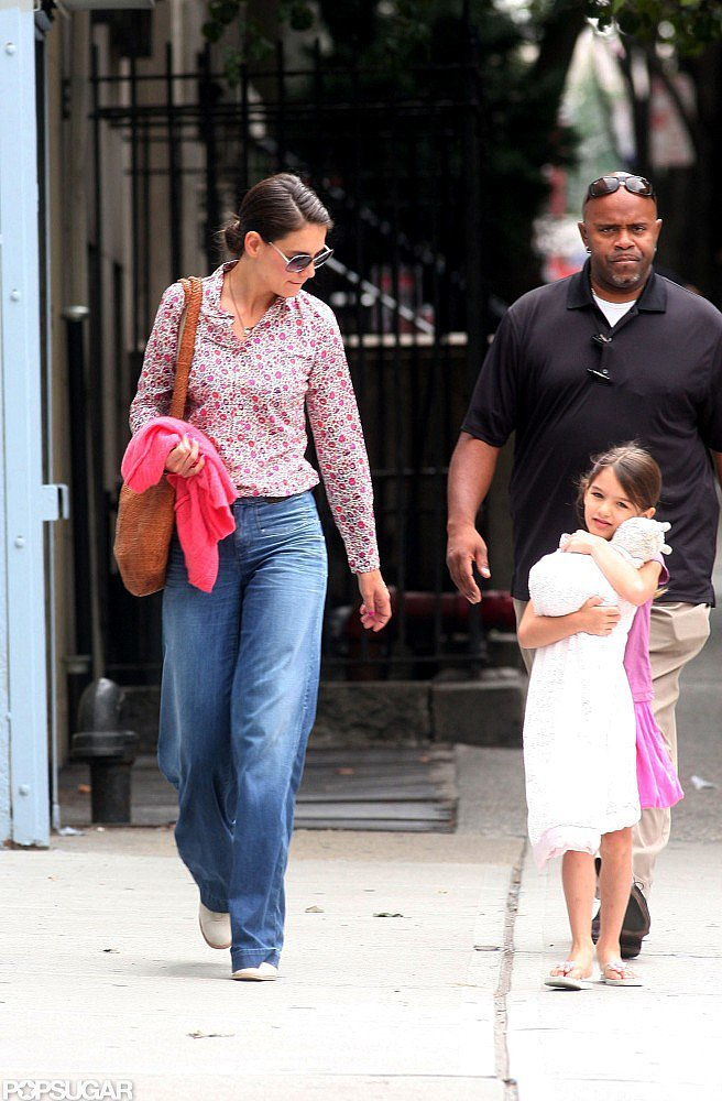 While strolling the streets of NYC with Suri in July 2012, Katie Holmes wore a J.Crew floral button-up blouse with a pair of wide-leg lightwash Goldsign jeans, creating the perfect '70s-inspired daytime look.