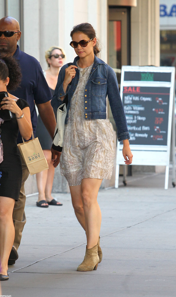 Showcasing her Summer style in a gauzy minidress, jean jacket, and Isabel Marant Dicker ankle boots in August 2012.