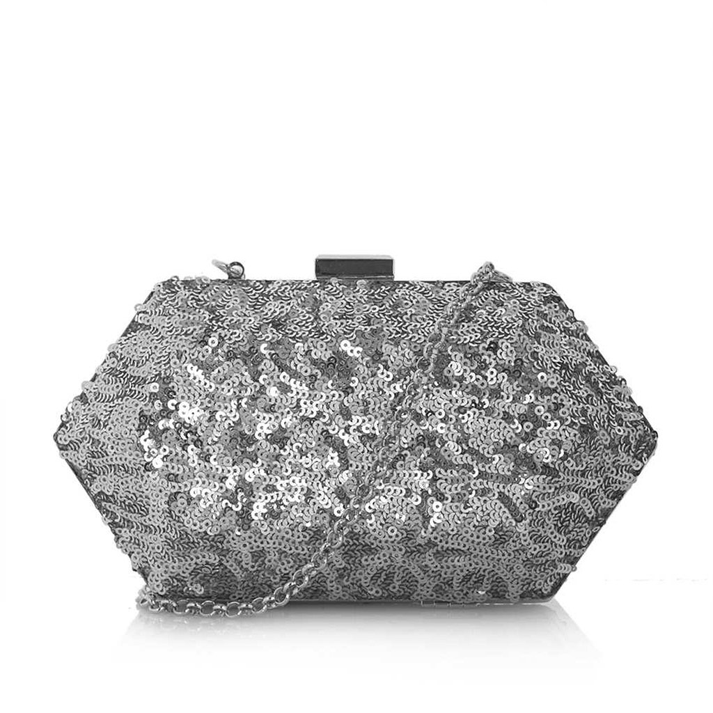 We're dazzled not only by the silver sequins on this Topshop clutch ($56) but also by its matching chain strap, so you'll have both hands free to carry that cocktail with ease.