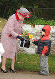 Queen Elizabeth II smiled at a little boy who greeted her with gifts in 2008.