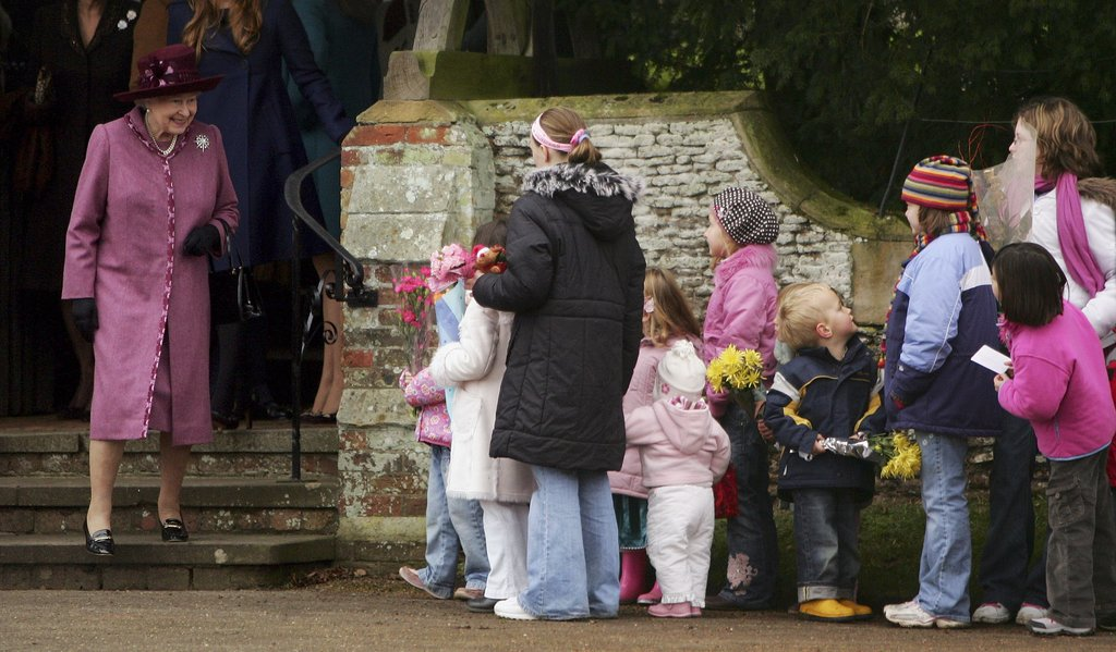 Queen Elizabeth II greeted kids as she left the Christmas Day service in Norfolk, England, in 2006.