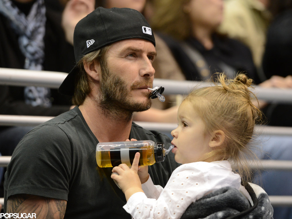 David and Harper logged some father-daughter bonding time during an LA Kings game in October — David kept track of Harper's pacifier while she chugged her juice.
