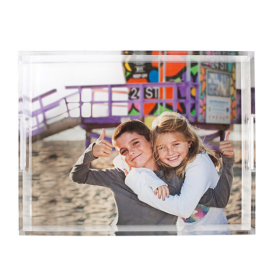 We love the idea of leaving the frame behind for an Erin Condren photo tray ($119). Display it on a coffee table or add it to your baby's changing table. So cute!