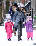 Sarah Jessica Parker walked with her daughters, Tabitha and Marion, on a snowy sidewalk in NYC in December 2013.