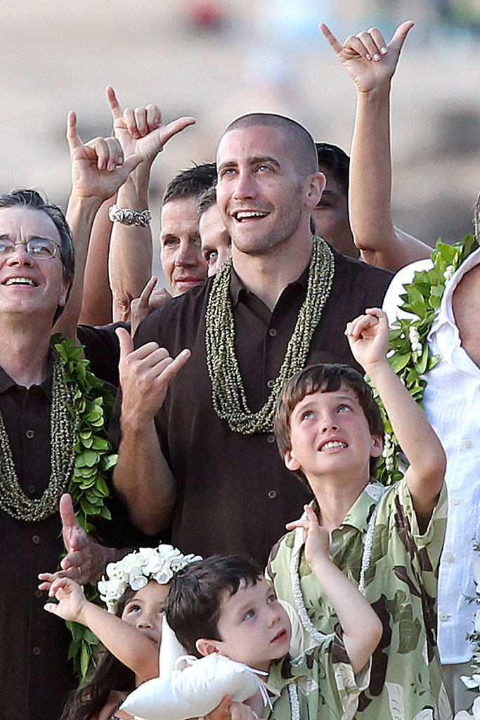 He got cute with family and friends during his dad's Hawaiian wedding in July 2011.