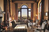 Arched windows that almost touch the vaulted ceilings give the living room a grandiose feel. Source: Teles Properties