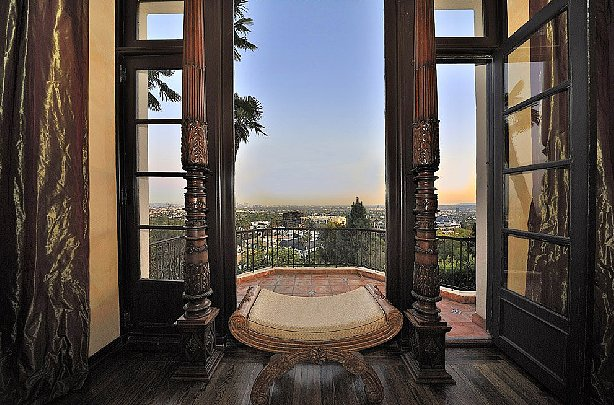 The terrace feels remarkably grand thanks to the ornately carved wooden pillars. Source: Teles Properties