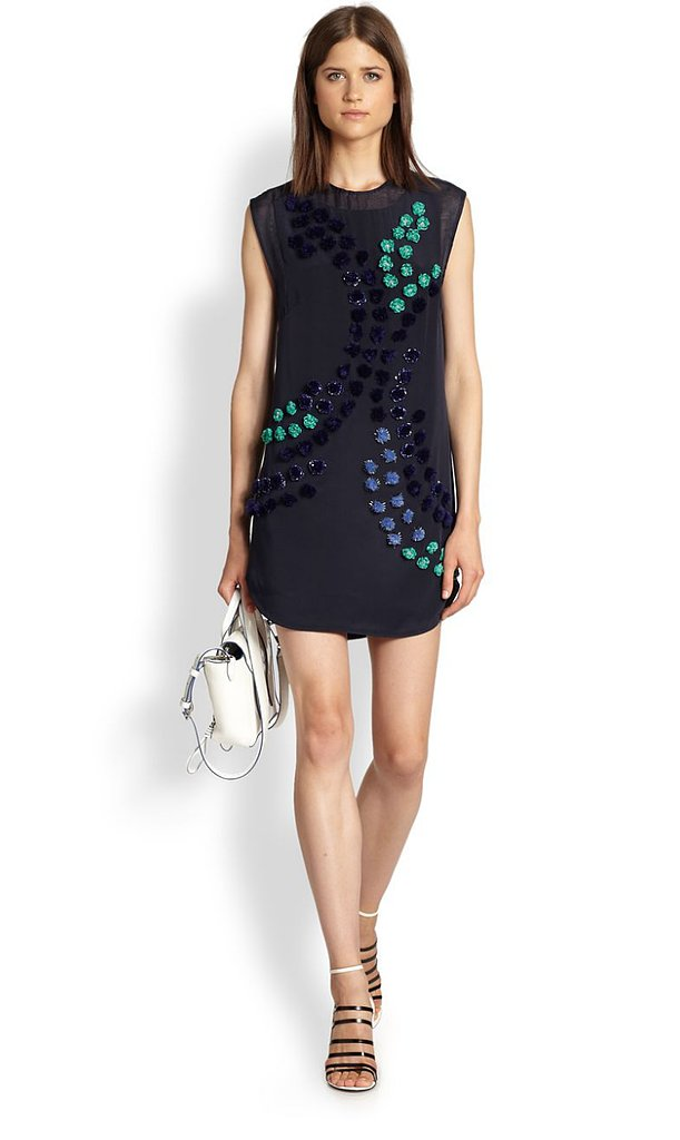 This 3.1 Phillip Lim silk shirttail dress ($650) reminds me of an art piece with its sparkling pom-poms and dandelion appliqués. Styled with black tights and a tux blazer, it can go straight from work to cocktails.   — MC