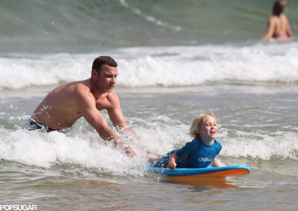 Liev Schreiber pushed his son through the waves.