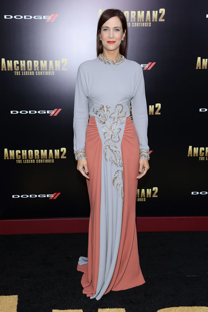 At the Anchorman 2: The Legend Continues premiere, ornamental embellishment added seasonal charm to Kristen Wiig's Prada design.