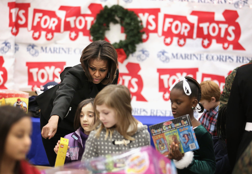 Michelle Obama helped a group of girls grab their toys at the event.