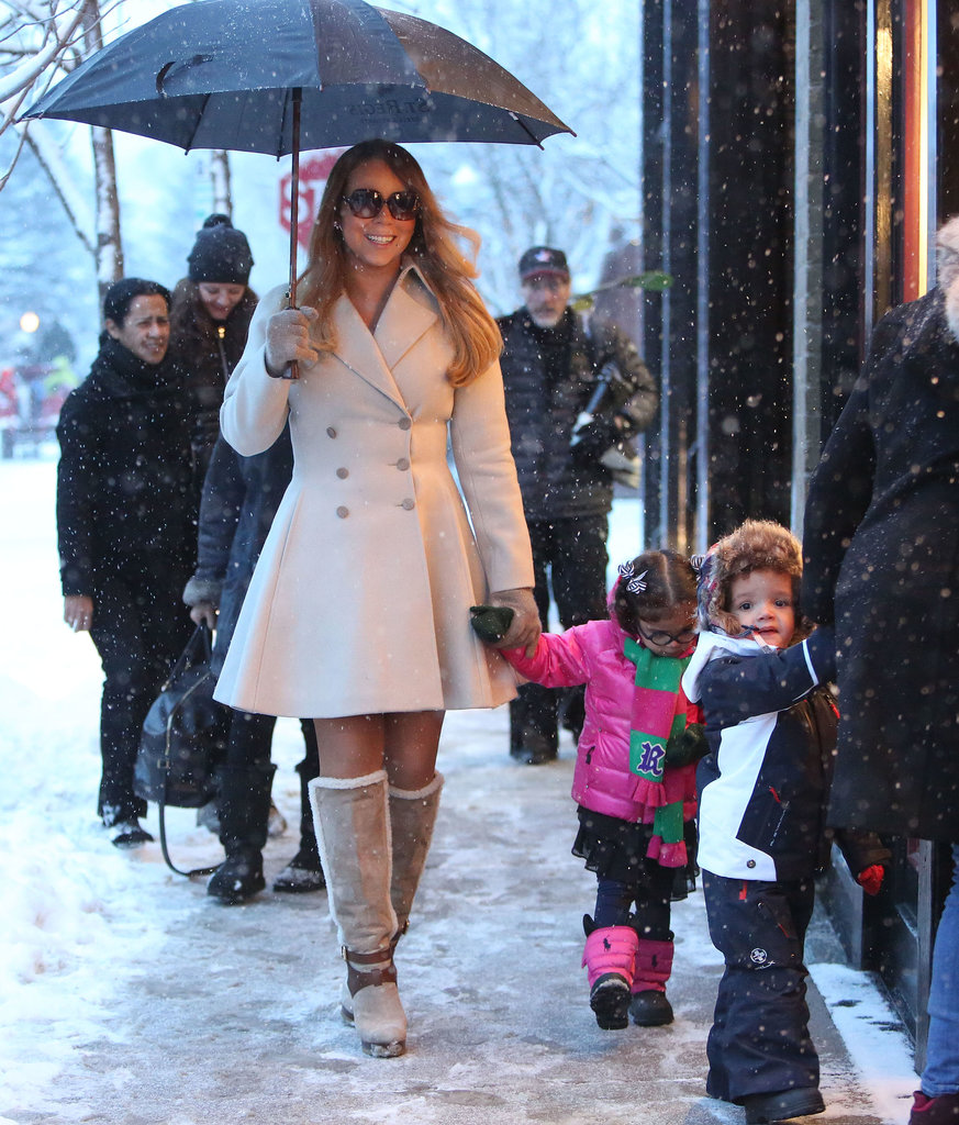 Mariah Carey held her umbrella while holding daughter Monroe's hand.
