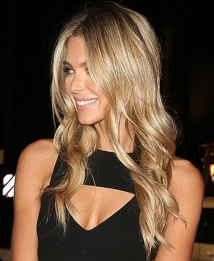 Loose ring curls and that famous golden glow — this is Jen at her tried-and-true best.