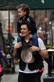 Orlando Bloom took his hat off for the piggyback ride with his son.