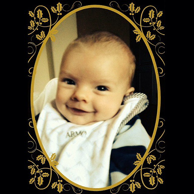 Fergie's little one, Axl, was all smiles on his first Christmas Eve. Source: Instagram user fergie