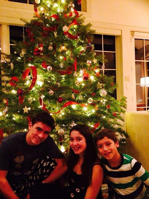 The Ripa-Consuelos family gathered around the Christmas tree. Source: Twitter user KellyRipa