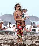Molly Sims hit the sand in Miami, FL, with her son, Brooks, on Monday.