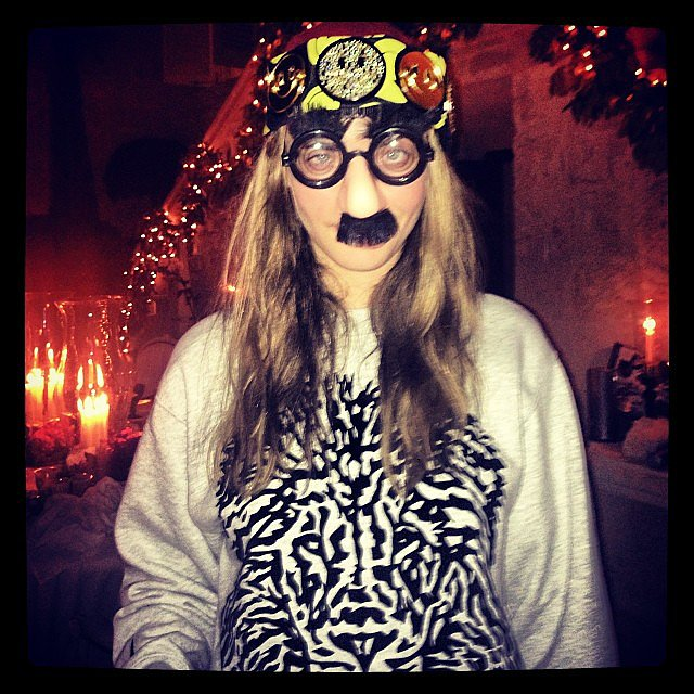 Cara Delevingne's Christmas getup was very . . . interesting. Source: Instagram user caradelevingne