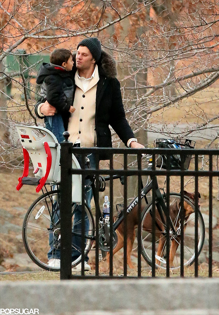 Tom held Benjamin near their bike.